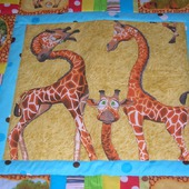 Детское лоскутное одеяло в кроватку Жирафики