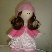 Кукла в розовой курточке