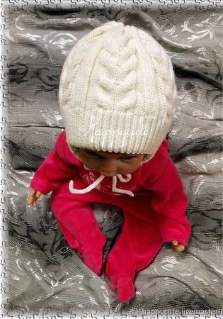 Зимняя шапка с косами ручной работы на заказ