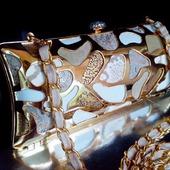 Клатч вечерний с металлическим узором и кожанной мозаикой