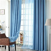 Плотные шторы голубого цвета из интерьерного софта