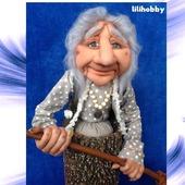 Кукла копилка Баба Яга в ступе с метлой