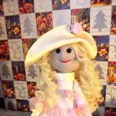 Кукла в нежно розовом платье с рюшами