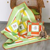 Детское лоскутное одеяло с вышивкой