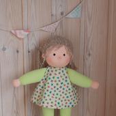 Куколка в пришивном комбинезончике