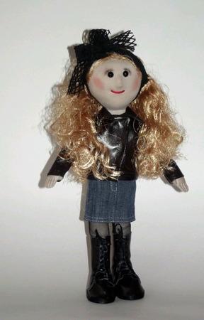 Кукла текстильная в кожаной куртке и джинсовой юбке ручной работы на заказ