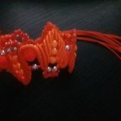 Браслет оранжевый в технике макраме