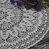 Круглая ажурная салфетка крючком белого цвета